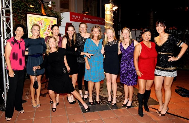 SINGAPORE - FEBRUARY 24:  (Left to right) Juli Inkster, Natalie Gulbis, Cristie Kerr, Nicole Castrale, Brittany Lang, Brittany Lincicome, Angela Stanford,  Morgan Pressel, Kristy McPherson, Christina Kim and Michelle Wie (all of the USA) pose for a photograph during the Welcome Reception prior to the start of the HSBC Women's Champions at the Tanah Merah Country Club  on February 24, 2010 in Singapore.  (Photo by Andrew Redington/Getty Images)