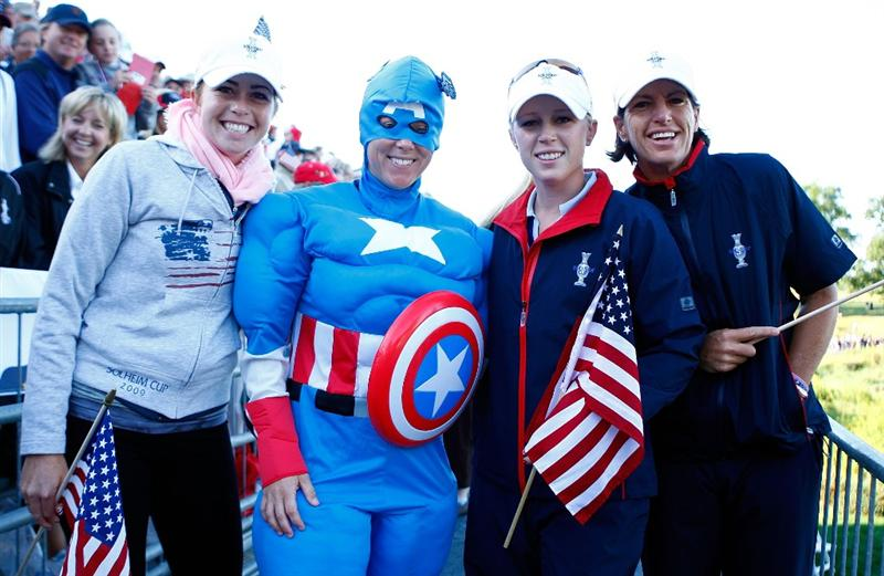 SUGAR GROVE, IL - AUGUST 22:  Paula Creamer, Morgan Pressel and Juli Inkster of the U.S. Team pose with a fan above the first tee during the saturday morning fourball matches at the 2009 Solheim Cup at Rich Harvest Farms on August 22, 2009 in Sugar Grove, Illinois.  (Photo by Scott Halleran/Getty Images)