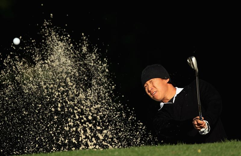 CHARLOTTE, NC - MAY 05:  Anthony Kim hits a shot from the sand on the 12th hole during the first round of the Wells Fargo Championship at Quail Hollow Club on May 5, 2011 in Charlotte, North Carolina.  (Photo by Streeter Lecka/Getty Images)