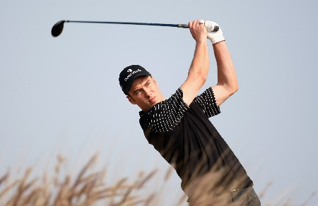 DOHA, QATAR - JANUARY 24:  Ross Fisher of England in action on the par four 16th hole during the first round of the Commercial Bank Qatar Masters held at the Doha Golf Club on January 24, 2008 in Doha,Qatar.  (Photo by Ross Kinnaird/Getty Images)
