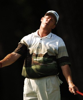 Woody Austin reacts after a missed putt on the eighth green during the first round of the PGA'S Bank of Amercia Colonial at Colonial Country Club in Forth Worth, Texas May 19, 2005.Photo by Steve Grayson/WireImage.com