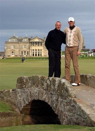 ST ANDREWS, SCOTLAND - OCTOBER 01:  Maarten Lafeber of Holland (ight) stands with Johan Cruyff, Holland football legend, on the Swilken Bridge on the 18th hole during the first round of The Alfred Dunhill Links Championship at The Old Course on October 1, 2009 in St. Andrews, Scotland. (Photo by Andrew Redington/Getty Images  (Photo by Andrew Redington/Getty Images)