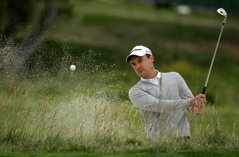 PEBBLE BEACH, CA - JUNE 15:  Simon Khan of England hits a shot from a bunker during a practice round prior to the start of the 110th U.S. Open at Pebble Beach Golf Links on June 15, 2010 in Pebble Beach, California.  (Photo by Andrew Redington/Getty Images)