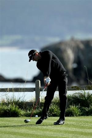 PEBBLE BEACH, CA - FEBRUARY 11:  Dustin Johnson hits his tee shot on the 18th hole during the first round of the AT&T Pebble Beach National Pro-Am at Pebble Beach Golf Links on February 11, 2010 in Pebble Beach, California.  (Photo by Stephen Dunn/Getty Images)