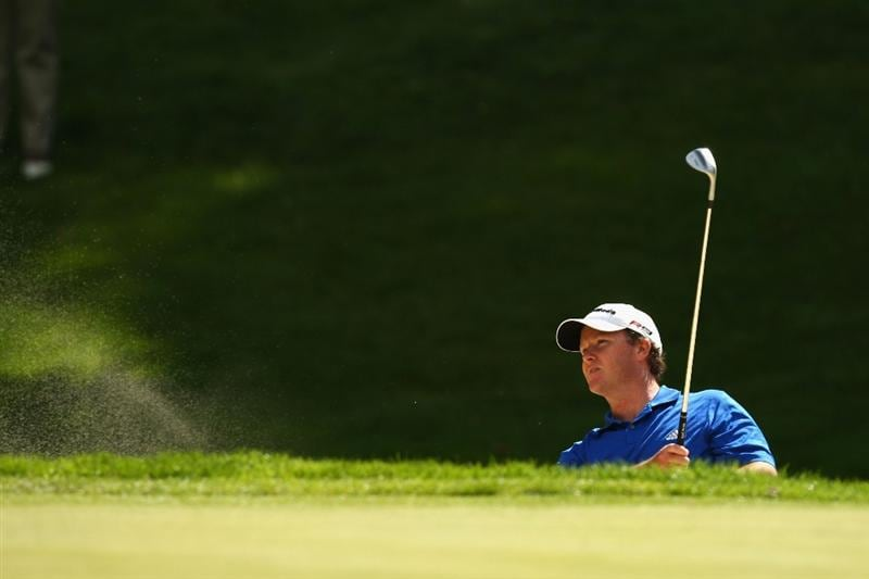 LUSS, SCOTLAND - JULY 10:  Marcus Fraser of Australia hits out of a bunker on the 15th hole during the Second Round of The Barclays Scottish Open at Loch Lomond Golf Club on July 10, 2009 in Luss, Scotland.  (Photo by Richard Heathcote/Getty Images)