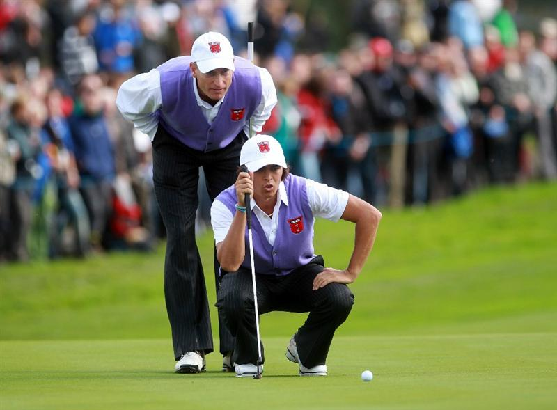 NEWPORT, WALES - OCTOBER 02:  Rickie Fowler of the USA lines up a putt with Jim Furyk  during the rescheduled Afternoon Foursome Matches during the 2010 Ryder Cup at the Celtic Manor Resort on October 2, 2010 in Newport, Wales.  (Photo by Andrew Redington/Getty Images)