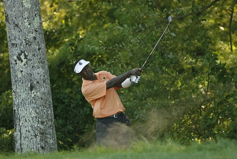 NORTON, MA - AUGUST 31: Vijay Singh of Fiji Islands hits his second shot on the 10th hole during the third round of the Deutsche Bank Championship at TPC Boston on August 31, 2008 in Norton, Massachusetts. (Photo by Hunter Martin/Getty Images)