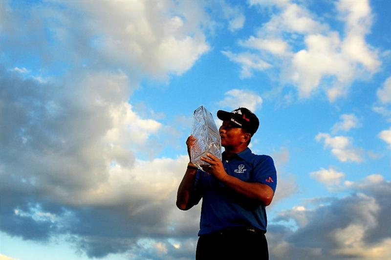 PONTE VEDRA BEACH, FL - MAY 15:  K.J. Choi of South Korea celebrates with the trophy after defeating David Toms on the first playoff hole to win THE PLAYERS Championship held at THE PLAYERS Stadium course at TPC Sawgrass on May 15, 2011 in Ponte Vedra Beach, Florida.  (Photo by Streeter Lecka/Getty Images)