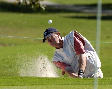 Ford president Steve Lyons blasts from the sand during the Miccosukee Champions Pro-Am March 2, 2005  at the Ford Championship at Doral in Miami.