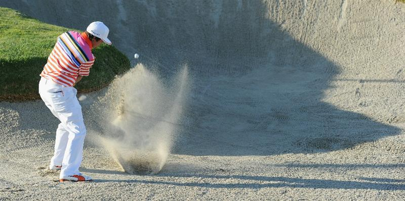 PACIFIC PALISADES, CA - FEBRUARY 17:  Rickie Fowler plays his bunker shot on the second hole during the first round of the Northern Trust Open at Riviera Country Club on February 17, 2011 in Pacific Palisades, California.  (Photo by Stuart Franklin/Getty Images)