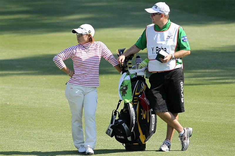 SHIMA, JAPAN - NOVEMBER 06:  Yukari Baba of Japan stands with her caddie on the 4th hole during the round two of the Mizuno Classic at Kintetsu Kashikojima Country Club on November 6, 2010 in Shima, Mie, Japan.  (Photo by Kiyoshi Ota/Getty Images)