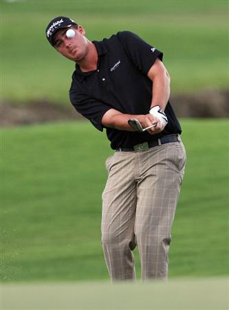 MIAMI - OCTOBER 15:  Michael Putman hits a chip shot on the seventh hole during the first round of the 2009 Nationwide Tour Miccosukee Championship at the Miccosukee Golf & Country Club on October 15, 2009 in Miami, Florida.  (Photo by Doug Benc/Getty Images)