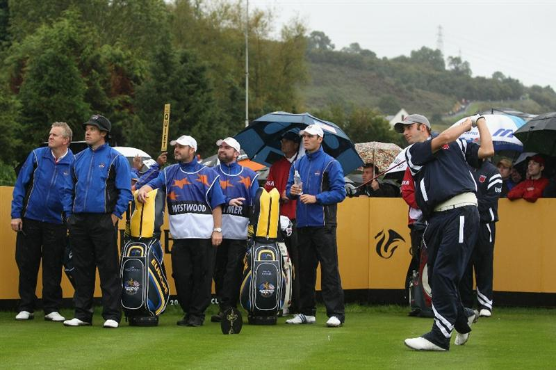 NEWPORT, WALES - OCTOBER 01:   Dustin Johnson of the USA tees off during the Morning Fourball Matches during the 2010 Ryder Cup at the Celtic Manor Resort on October 1, 2010 in Newport, Wales. (Photo by Ross Kinnaird/Getty Images)