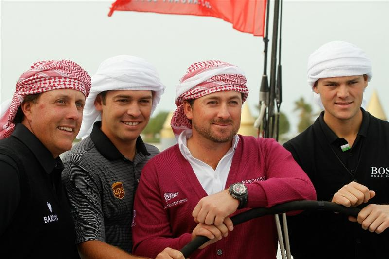 ABU DHABI, UNITED ARAB EMIRATES - JANUARY 18:  (L to R) 2010 Major Champions, Phil Mickelson of the USA, Louis Oosthuizen of South Africa, Graeme McDowell of Northern Ireland and Martin Kaymer of Germany pose on the Abu Dhabi Ocean Racing entry for the 2011 Volvo Ocean Race a preview to the 2011 Abu Dhabi HSBC Golf Championship  at the Abu Dhabi Golf Club on January 18, 2011 in Abu Dhabi, United Arab Emirates.  (Photo by Scott Halleran/Getty Images)