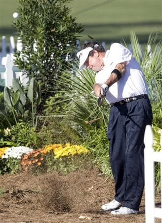 THE WOODLANDS, TX - OCTOBER 18:  Bruce Lietzke hits out of a flower bed  on the eighteenth hole during the final round of the Administaff Small Business Classic at The Woodlands Country Club Tournament Course on October 18, 2009 in The Woodlands, Texas.  (Photo by Bob Levey/Getty Images)
