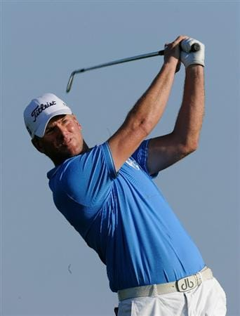 VILAMOURA, PORTUGAL - OCTOBER 16:  Robert Karlsson of Sweden plays his approach shot on the 18th hole during the third round of the Portugal Masters at the Oceanico Victoria Golf Course on October 16, 2010 in Villamoura, Portugal.  (Photo by Stuart Franklin/Getty Images)