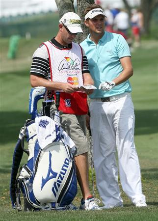 ORLANDO, FL - MARCH 26:  Jeff Overton of the USA checks yardage with his caddie during the first round of the Arnold Palmer Invitational Presented by Mastercard at the Bay Hill Club and Lodge on March 26, 2009 in Orlando, Florida  (Photo by David Cannon/Getty Images)