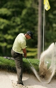 Tiger Woods hits his ball out of the bunker at the fourth hole during the first round of the Deutsche Bank Championship at TPC Boston on August 31, 2007 in Norton, Massachusetts. PGA Tour - 2007 Deutsche Bank Championship - First RoundPhoto by Stan Badz/PGA TOUR/WireImage.com
