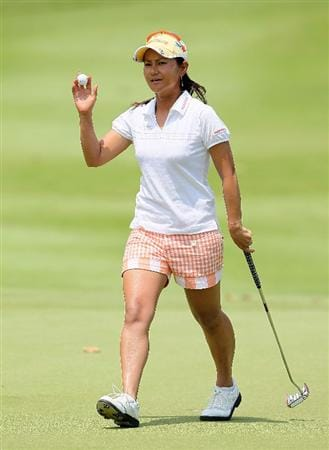 SINGAPORE - FEBRUARY 28:  Ai Miyazato of Japan waves to the crowd after making a birdie on the 16th hole during the final round of the HSBC Women's Champions at Tanah Merah Country Club on February 28, 2010 in Singapore, Singapore.  (Photo by Andy Lyons/Getty Images)