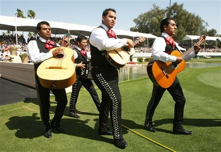 RANCHO MIRAGE, CA - APRIL 06:  A band of mariachis play as they walk onto the 18th green in honor of Mexican Lorena Ochoa's victory after the final round of the Kraft Nabisco Championship at Mission Hills Country Club on April 6, 2008 in Rancho Mirage, California.  (Photo by Stephen Dunn/Getty Images)