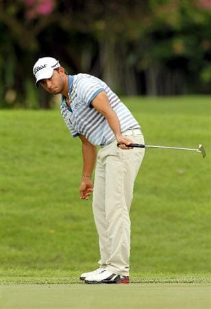 SINGAPORE - NOVEMBER 12 : Pablo Larrazabal of Spain reacts to a putt on the 15th hole during the delayed first round of the Barclays Singapore Open held at the Sentosa Golf Club on November 12, 2010 in Singapore, Singapore.  (Photo by Stanley Chou/Getty Images)