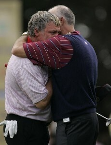 Darren Clarke of Europe (L) is embraced by USA Captain Tom Lehman (R) following the Singles at the 2006 Ryder Cup held at the K Club, Straffan, County Kildare, Ireland on Sunday, September 24, 2006. Photo by Sam Greenwood/WireImage.com