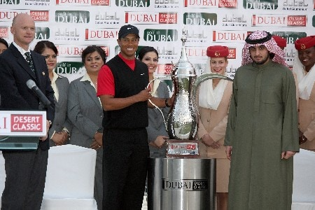 DUBAI, UNITED ARAB EMIRATES - FEBRUARY 03:  Tiger Woods of the USA is presented with the trophy by Shaikh Ahmed Bin Mohammed Bin Rashid Al Maktoum son of His Highness Shaikh Mohammed Bin Rashid Al Maktoum Vices President and Prime Minister of the UAE and Ruler of Dubai after winning the Dubai Desert Classic, on the Majilis Course at the Emirates Golf Club, on February 3, 2008 in Dubai, United Arab Emirates.  (Photo by David Cannon/Getty Images)