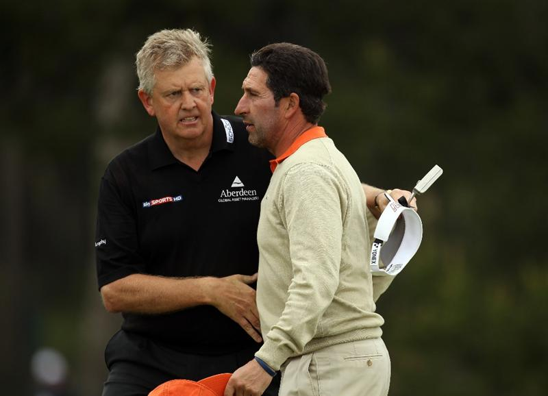 BARCELONA, SPAIN - MAY 07:  Colin Montgomerie of Scotland and Jose Maria Olazabal of Spain on the 18th green, following news of the death of Seve Ballesteros,  during the third round of the Open de Espana at the the Real Club de Golf El Prat on May 7 , 2011 in Barcelona, Spain.  (Photo by Ross Kinnaird/Getty Images)