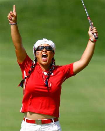 SUGAR GROVE, IL - AUGUST 23:  Christina Kim of the U.S. Team celebrates a winning the 14th hole during the Sunday singles matches at the 2009 Solheim Cup at Rich Harvest Farms on August 23, 2009 in Sugar Grove, Illinois.  (Photo by Scott Halleran/Getty Images)
