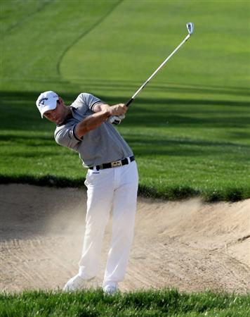 DUBAI, UNITED ARAB EMIRATES - FEBRUARY 04:  Oliver Wilson of England on the par four 12th hole during the first round the Omega Dubai Desert Classic on the Majlis Course at the Emirates Golf Club on February 4, 2010 in Dubai, United Arab Emirates.  (Photo by Ross Kinnaird/Getty Images)