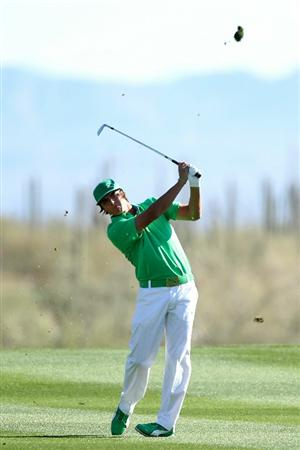 MARANA, AZ - FEBRUARY 23:  Rickie Fowler hits his second shot on the 14th hole during the first round of the Accenture Match Play Championship at the Ritz-Carlton Golf Club on February 23, 2011 in Marana, Arizona.  (Photo by Andy Lyons/Getty Images)