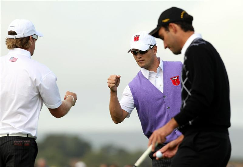 NEWPORT, WALES - OCTOBER 02:  Zach Johnson (C) and Hunter Mahan of the USA celebrate after winning the first hole as Edoardo Molinari looks on during the rescheduled Afternoon Foursome Matches during the 2010 Ryder Cup at the Celtic Manor Resort on October 2, 2010 in Newport, Wales. (Photo by Ross Kinnaird/Getty Images)