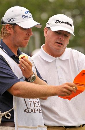SAN ANTONIO TX - MAY 16: Paul Goydos checks yardage with his caddy on the 1st tee during the third round of  the Valero Texas Open held at La Cantera Golf Club on May 16, 2009 in San Antonio, Texas.  (Photo by Marc Feldman/Getty Images)