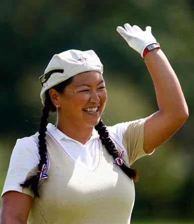 SUGAR GROVE, IL - AUGUST 20:  Christina Kim of the U.S. Team waves to the gallery during a practice round prior to the start of the 2009 Solheim Cup at Rich Harvest Farms on August 20, 2009 in Sugar Grove, Illinois.  (Photo by Scott Halleran/Getty Images)