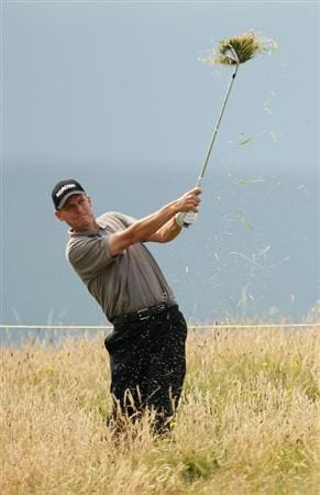 TURNBERRY, SCOTLAND - JULY 16:   Anders Hansen of Denmark hits from the rough during round one of the 138th Open Championship on the Ailsa Course, Turnberry Golf Club on July 16, 2009 in Turnberry, Scotland.  (Photo by Ross Kinnaird/Getty Images)