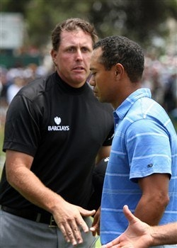 SAN DIEGO - JUNE 12:  Phil Mickelson shakes hands with Tiger Woods on the 18th green during the first round of the 108th U.S. Open at the Torrey Pines Golf Course (South Course) on June 12, 2008 in San Diego, California.  (Photo by Ross Kinnaird/Getty Images)