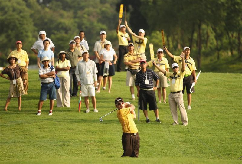KUALA LUMPUR, MALAYSIA - APRIL 14:  Louis Oosthuizen of South Africa in action during the first round of the Maybank Malaysian Open at Kuala Lumpur Golf & Country Club on April 14, 2011 in Kuala Lumpur, Malaysia.  (Photo by Ian Walton/Getty Images)