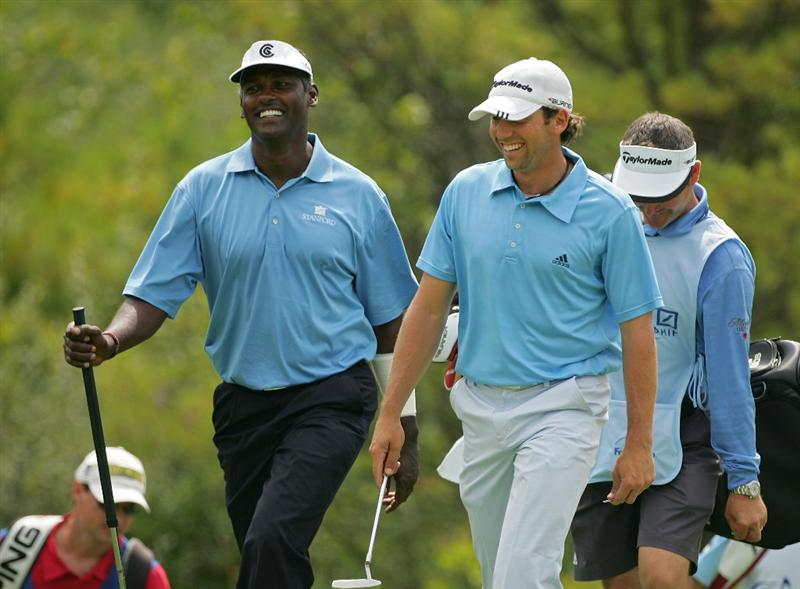 NORTON, MA - AUGUST 29:  Vijay Singh (L) of Fiji and Sergio Garcia share a laugh during the first round of the Deutsche Bank Championship at TPC of Boston held on August 29, 2008 in Norton, Massachusetts.  (Photo by Michael Cohen/Getty Images)