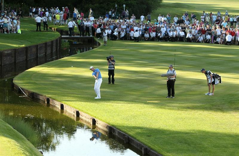 VIRGINIA WATER, ENGLAND - MAY 23:  Robert Karlsson of Sweden chips to the 18th green during the final round of the BMW PGA Championship on the West Course at Wentworth on May 23, 2010 in Virginia Water, England.  (Photo by Ian Walton/Getty Images)