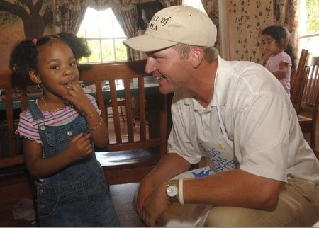 Jason Bohn greets children at the Respite Care after helping decorating cookies during the PGA TOUR's Player Charity Visit for the 2005 Valero Texas Open in San Antonio, Texas September 20, 2005 .Photo by Steve Grayson/WireImage.com