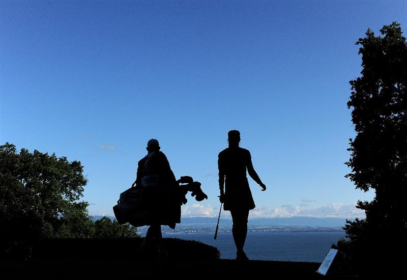 EVIAN-LES-BAINS, FRANCE - JULY 25:  Maria Verchenova of Russia and caddie on the second during the third round of the Evian Masters at the Evian Masters Golf Club on July 25, 2009 in Evian-les-Bains, France.  (Photo by Stuart Franklin/Getty Images)