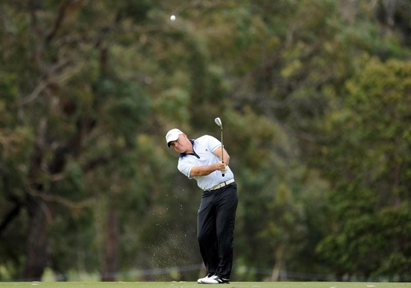 MELBOURNE, AUSTRALIA - NOVEMBER 27:  Phillip Archer of England plays a shot off the fairway onto the green during the first round of the 2008 Australian Masters at Huntingdale Golf Club on November 27, 2008 in Melbourne, Australia  (Photo by Robert Cianflone/Getty Images)
