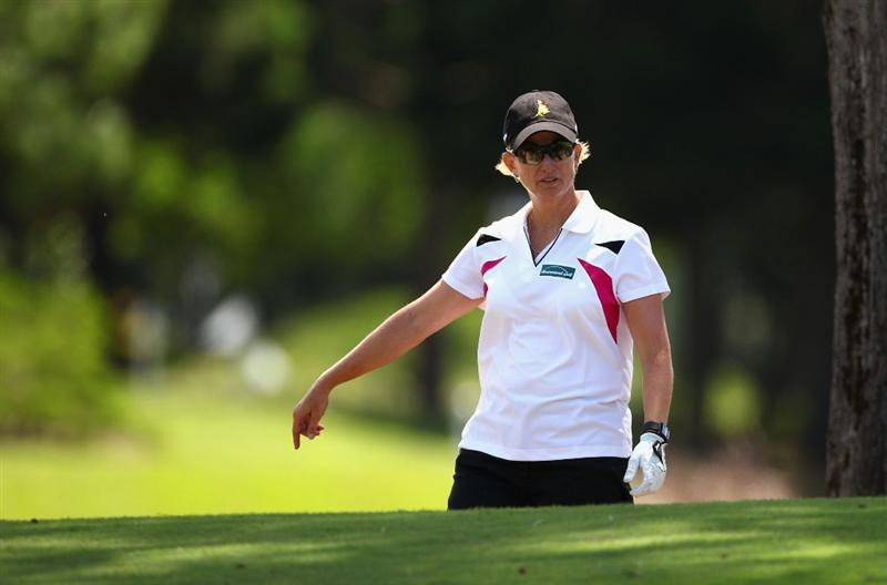 GOLD COAST, AUSTRALIA - MARCH 04:  Karrie Webb of Australia looks dejected after hitting her ball into the bunker on the 8th hole during round one of the 2010 ANZ Ladies Masters at Royal Pines Resort on March 4, 2010 in Gold Coast, Australia.  (Photo by Ryan Pierse/Getty Images)
