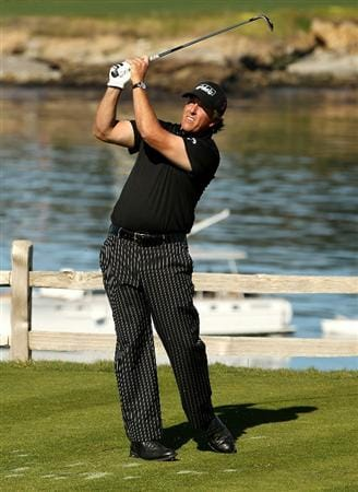 PEBBLE BEACH, CA - FEBRUARY 12:  Phil Mickelson tees off on the 7th hole during the third round of the AT&T Pebble Beach National Pro-Am at the Pebble Beach Golf Links on February 12, 2011 in Pebble Beach, California.  (Photo by Ezra Shaw/Getty Images)