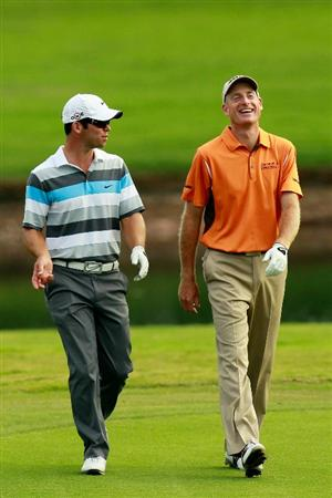 ATLANTA - SEPTEMBER 24:  Paul Casey of England (L) and Jim Furyk walk up the 17th fairway during the second round of THE TOUR Championship presented by Coca-Cola at East Lake Golf Club on September 24, 2010 in Atlanta, Georgia.  (Photo by Kevin C. Cox/Getty Images)