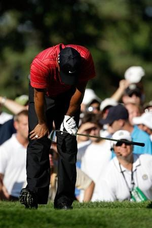 CHASKA, MN - AUGUST 16:  Tiger Woods reacts to his poor tee shot on the 17th hole during the final round of the 91st PGA Championship at Hazeltine National Golf Club on August 16, 2009 in Chaska, Minnesota.  (Photo by Jamie Squire/Getty Images)