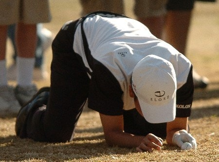 Kevin Na checks the lie of his ball after his second shot during the second hole of a two hole playoff against eventual winner Geoff Ogilvy in the final round of the PGA's Tour 2005 Chrysler Classic of Tucson at the Omni Tucson National Golf Resort & Spa February 27, 2005 in Tuscon, Arizona.