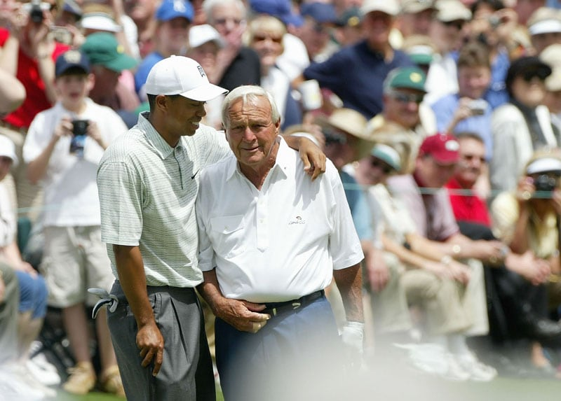 Tiger Woods and Arnold Palmer