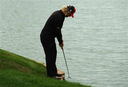 IRVING, TEXAS - APRIL 27:  Charley Hoffman practices his putting stroke while standing over the water by the 14th green during the final round of the EDS Byron Nelson Championship at TPC Four Seasons Resort Las Colinas April 27, 2008 in Irving, Texas.  (Photo by Stephen Dunn/Getty Images)