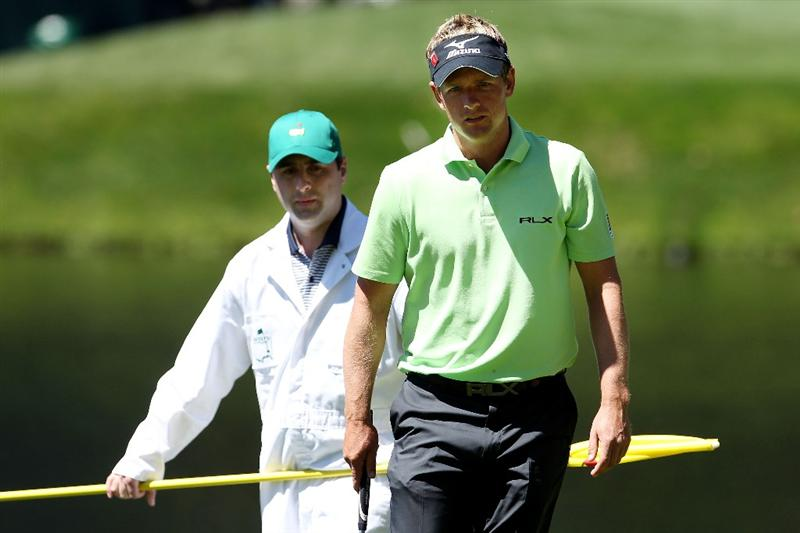 AUGUSTA, GA - APRIL 06:  Luke Donald of England lines up a putt during the Par 3 Contest prior to the 2011 Masters Tournament at Augusta National Golf Club on April 6, 2011 in Augusta, Georgia.  (Photo by Andrew Redington/Getty Images)
